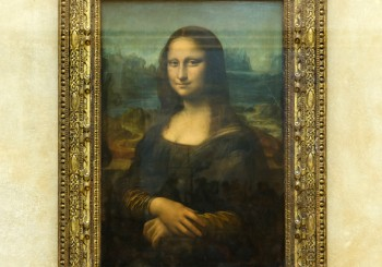 """Paris France - May 13 2015: Leonardo DaVinci's """"Mona Lisa"""" at the Louvre Museum May 13 2015 in Paris France. The painting is one of the world's most famous."""